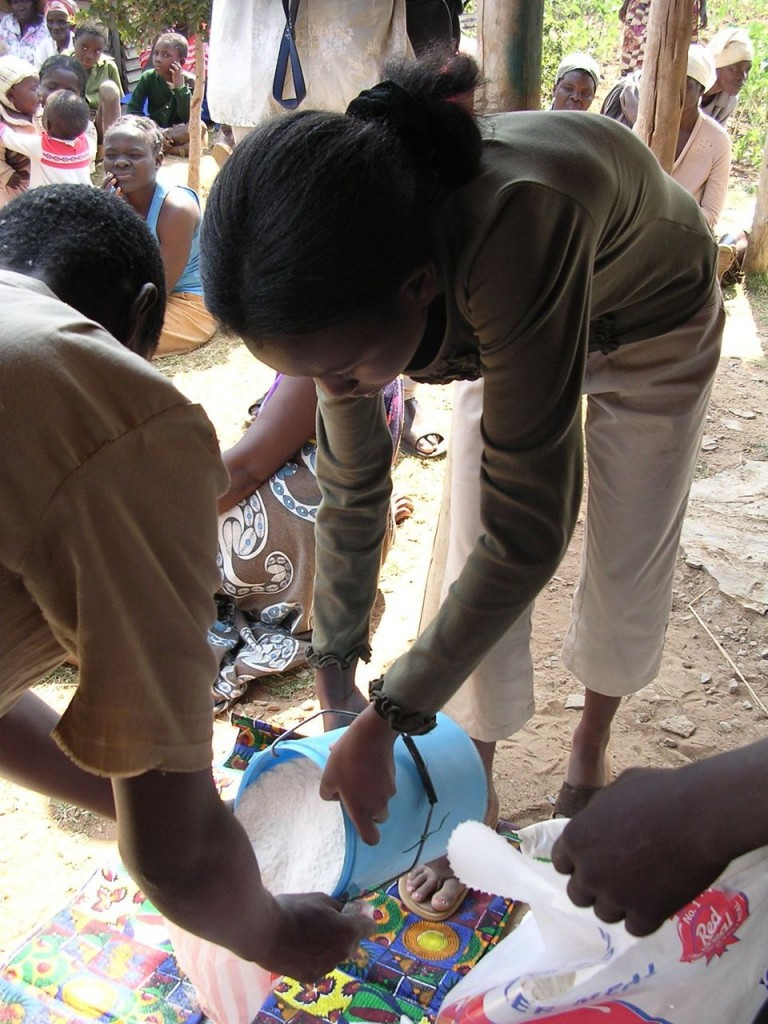 Arundel Girls' School student Rumbi, distributes the ground maize-meal